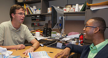 Durant meets weekly with faculty mentor Jamie Hestekin to discuss his progress in the lab.