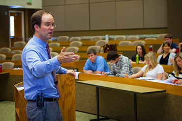 Professor Dustin Buehler introduces first-year law students to the basics of civil procedure in the law school's 200-seat E.J. Ball Courtroom.