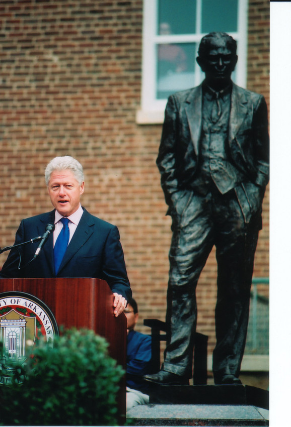 President Bill Clinton addresses a crowd gathered on the University of Arkansas.