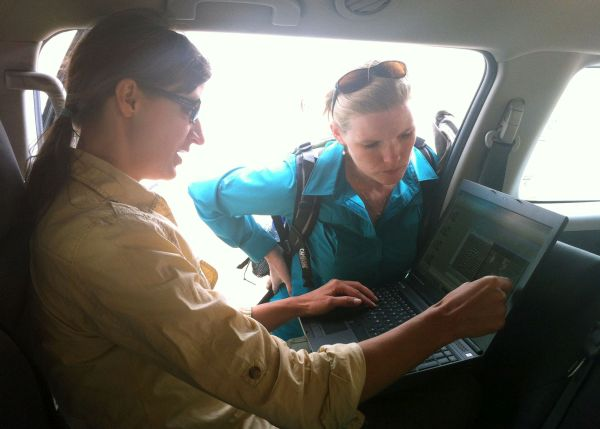 Katie Simon (left) and Eileen Ernenwein discuss data on location at Petra, Jordan.